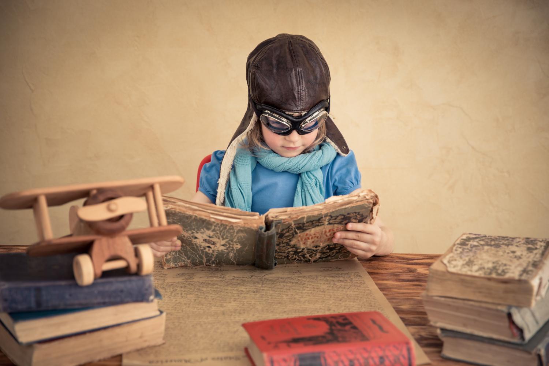Costumed Child Reading