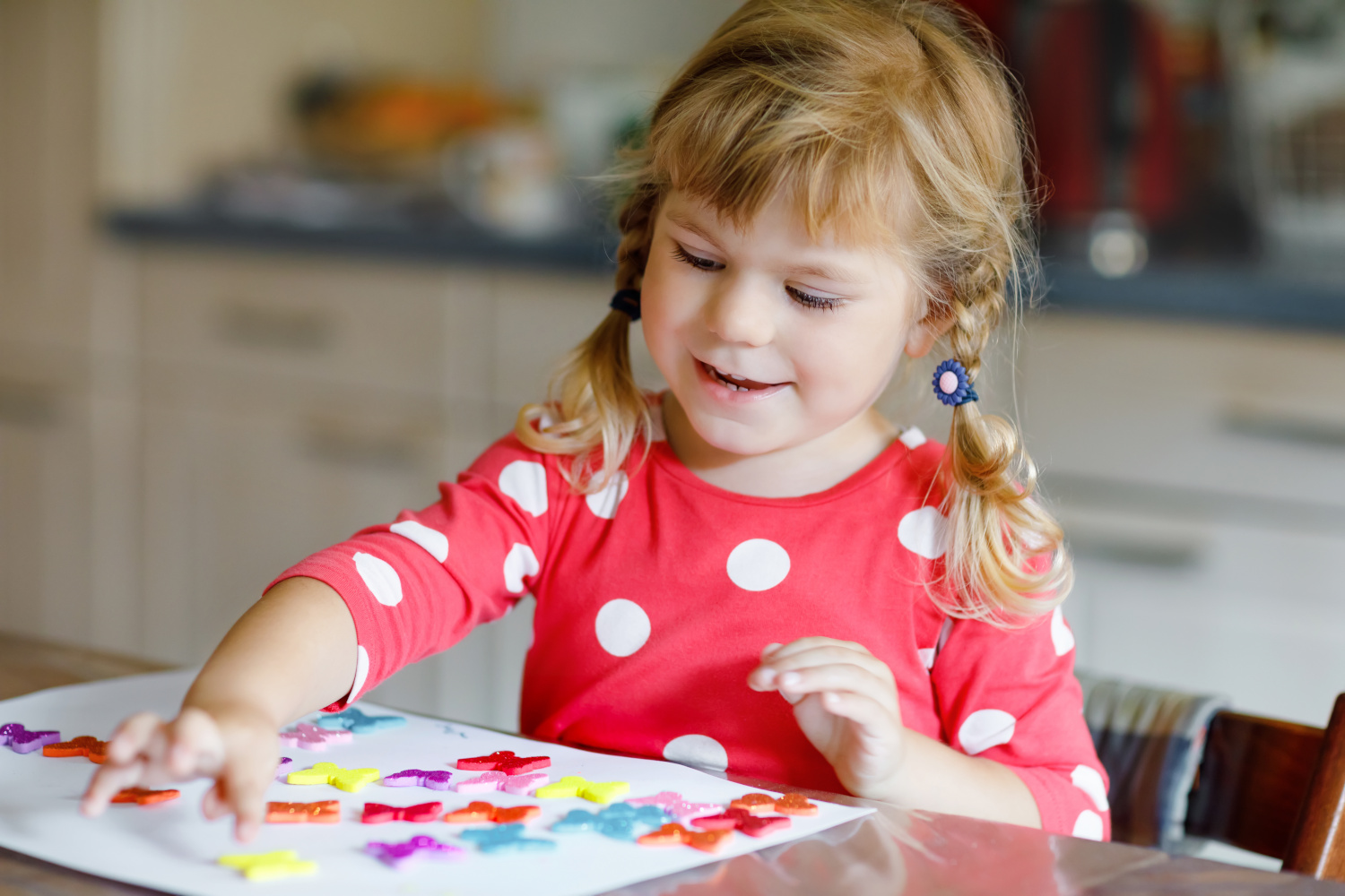 Child Playing With Stickers