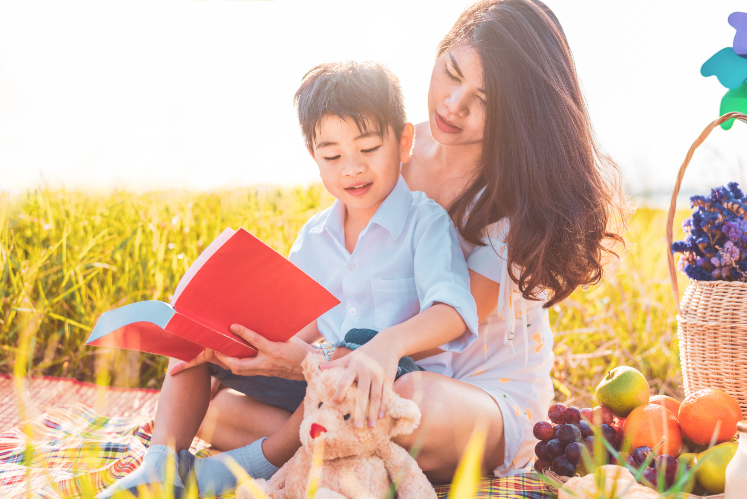Mother and Child Reading Outside