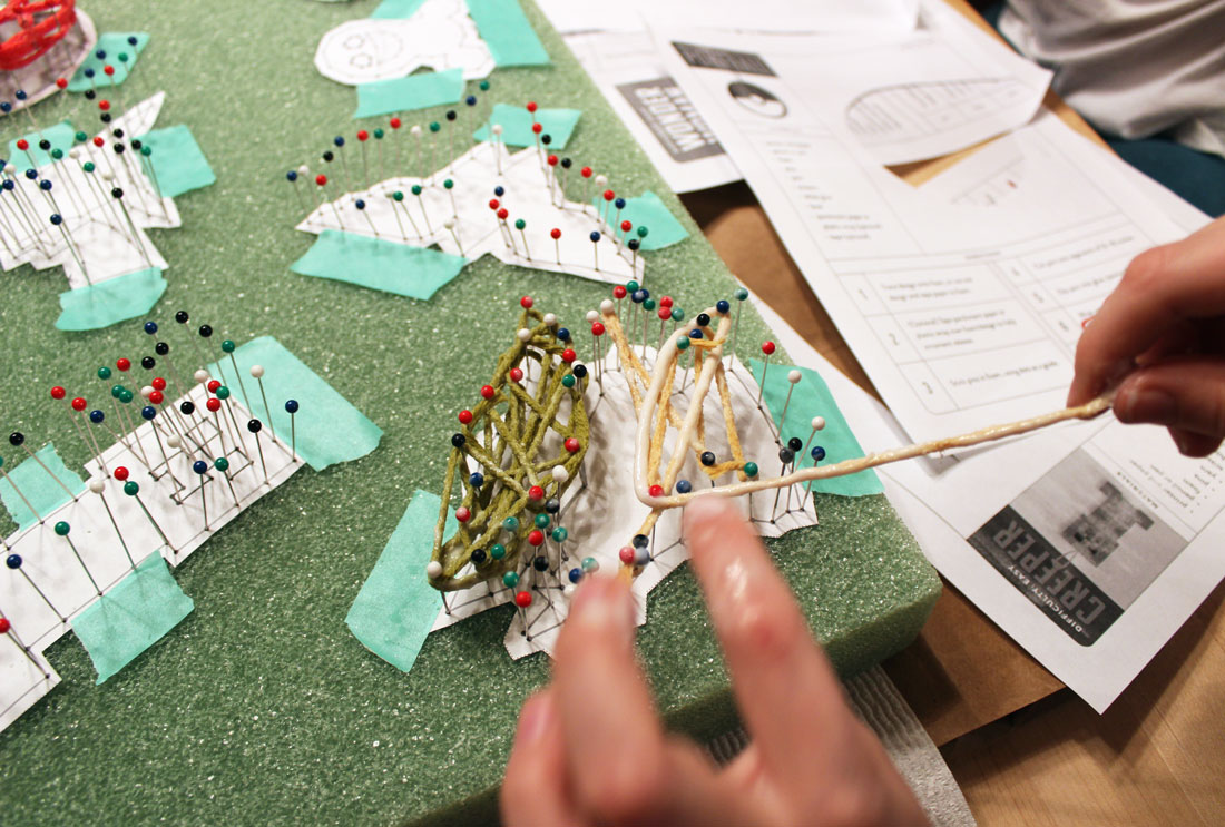 Wrap yarn around pins