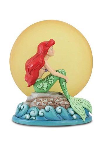 Ariel Sitting on Rock by Moon Statue